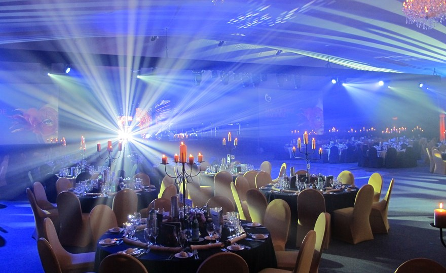 corporate masquerade ball table setup at HBF Stadium