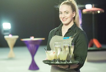 Waitress with drinks tray at function at HBF Stadium