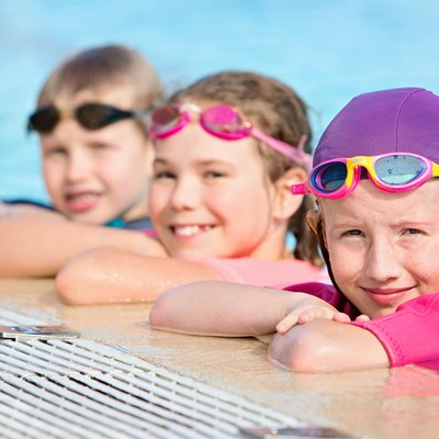 Kids-on-edge-of-pool-during-swimming-lesson-at-HBF-Stadium.jpg